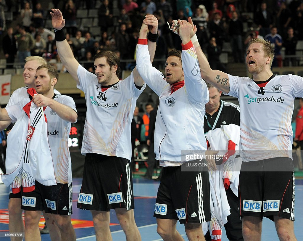 Germany's players celebrate after winning the 23rd Men's Handball World Championships preliminary round Group A match France vs Germany at the Palau Sant Jordi in Barcelona on January 18, 2013. Germany won 32-30. AFP PHOTO/ LLUIS GENE