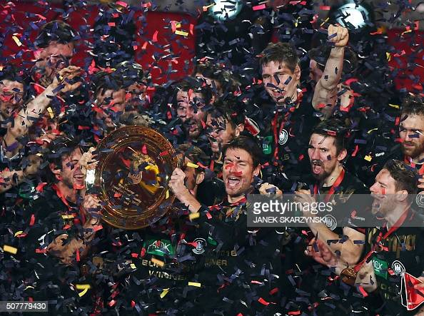 TOPSHOT Germany's players celebrate after winning the final match of the Men's 2016 EHF European Handball Championship between Germany and Spain in...