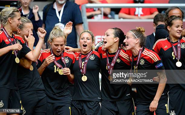 Germany's players celebrate after winning the UEFA Women's European Championship Euro 2013 final Germany vs Norway on July 28 2013 in Solna Sweden...