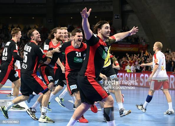 Germany's players celebrate after winning their match against Denmark after the Men's 2016 EHF European Handball Championship match between Germany...