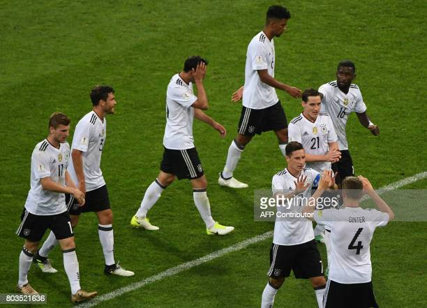 Germany's players celebrate at the end of the 2017 Confederations Cup semifinal football match between Germany and Mexico at the Fisht Stadium in...