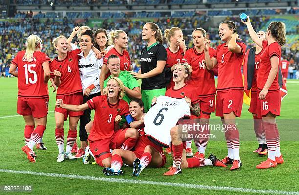 Germany's players celebrate following the Rio 2016 Olympic Games women's football Gold medal final match at the Maracana stadium in Rio de Janeiro...