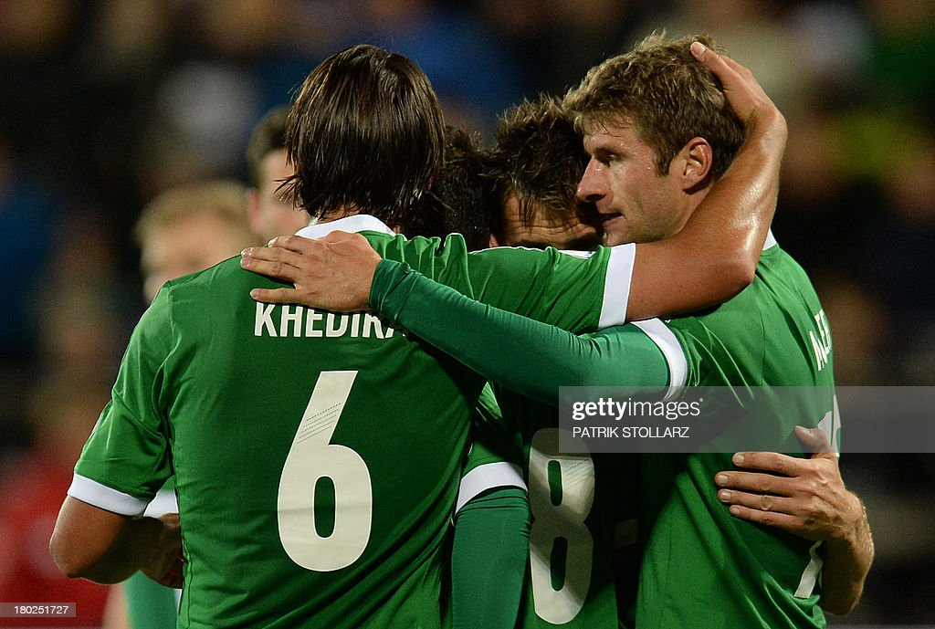 Germany's players celebrate scoring during the FIFA World Cup 2014 qualifying football match Faroe Island vs Germany in Torshavn on September 10, 2013. AFP PHOTO / PATRIK STOLLARZ