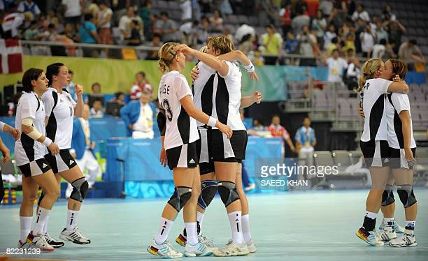 Germany's players celebrate their victory over Brazil following the women's preliminary Group B handball match for the 2008 Olympic Games in Beijing...