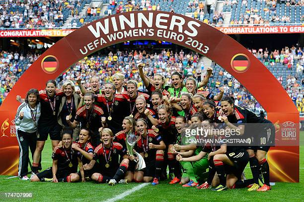 Germany's players celebrate with the trophy after winning the UEFA Women's European Championship Euro 2013 final Germany vs Norway on July 28 2013 in...