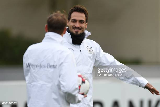 Germany's players including defender Mats Hummels take part in a training session in Dortmund western Germany on March 21 on the eve of the friendly...