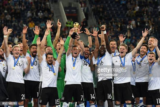 TOPSHOT Germany's players lift the trophy after winning the 2017 Confederations Cup final football match between Chile and Germany at the Saint...