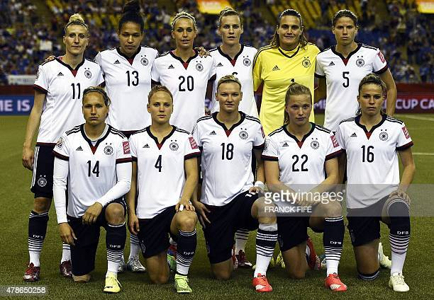 Germany's players pose before the quarterfinal football match between Germany and France in the 2015 FIFA Women's World Cup at the Olympic Stadium in...