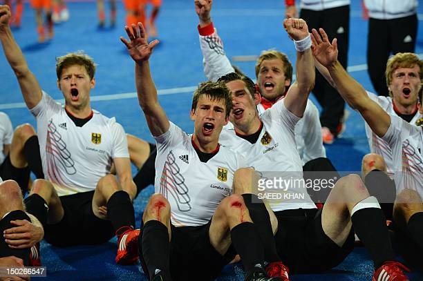 Germany's players react after defeating the Netherlands after the men's field hockey gold medal match Germany vs the Netherlands at the London 2012...