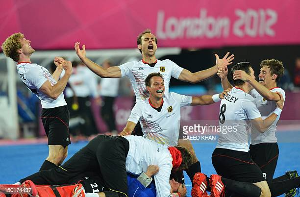 Germany's players react after the men's field hockey gold medal match Germany vs the Netherlands at the London 2012 Olympic Games in London on August...