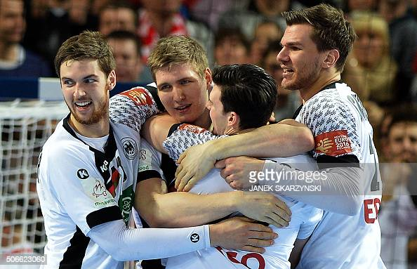 Germany's players react after winning against Russia during the Men's 2016 EHF European Handball Championships between Germany and Russia in...