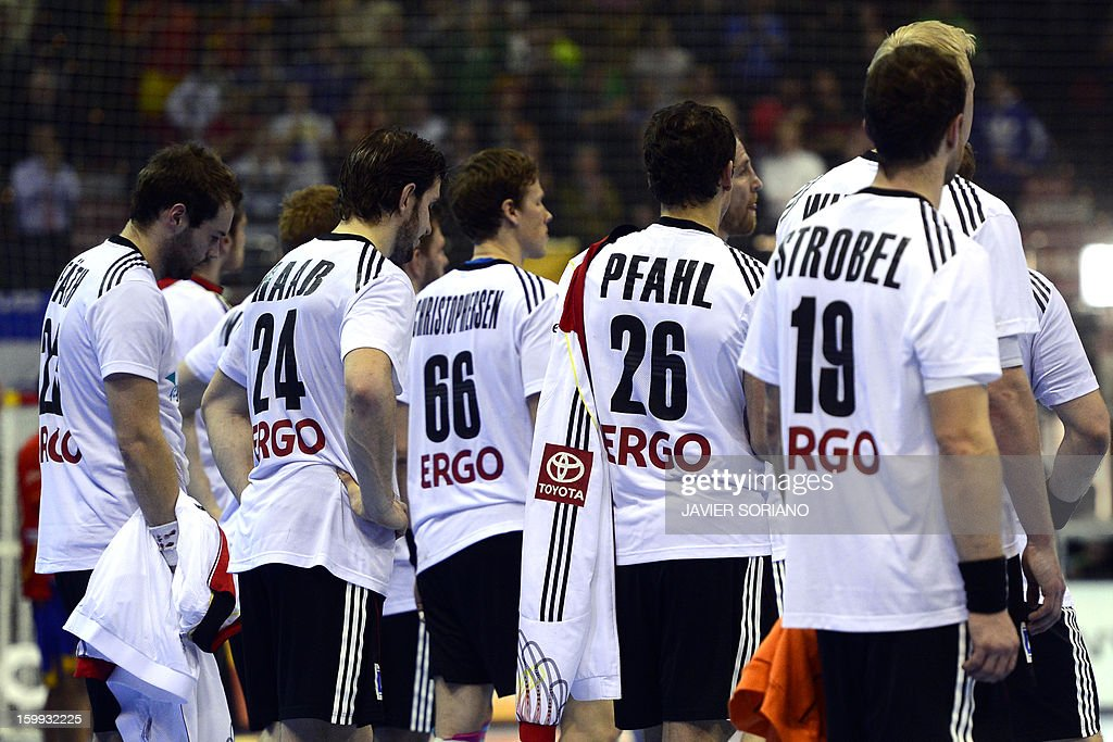 Germany's players react at the end of the 23rd Men's Handball World Championships quarterfinal match Spain vs Germany at the Pabellon Principe Felipe...
