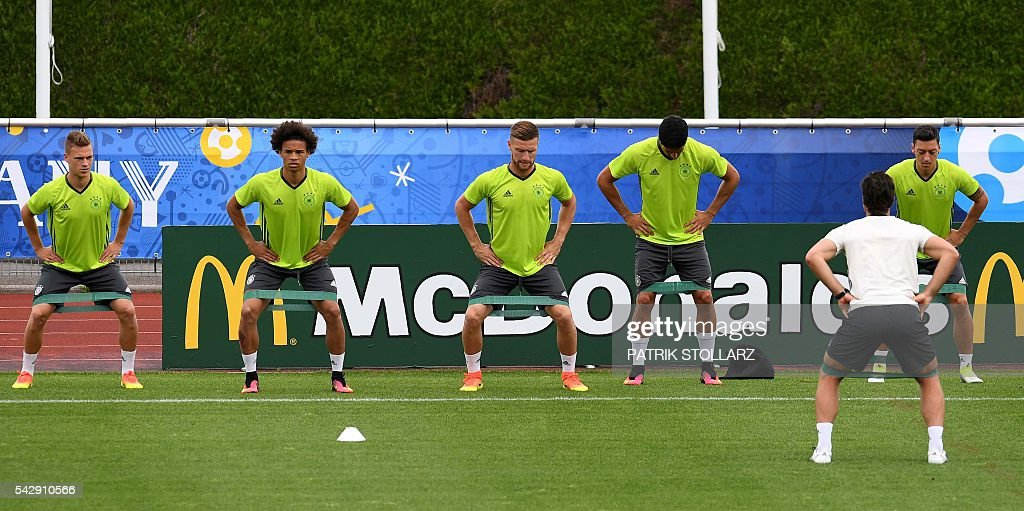 Germany's players warm up during a training session at the team's training ground in Evian-les-Bains, south-eastern France, on June 25, 2016, on the eve of the Euro 2016 round of sixteen football match between Germany and Slovakia. / AFP / PATRIK