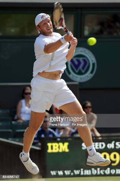 Germany's Rainer Schuettler in action against Spain's Rafael Nadal during the Wimbledon Championships 2008 at the All England Tennis Club in Wimbledon
