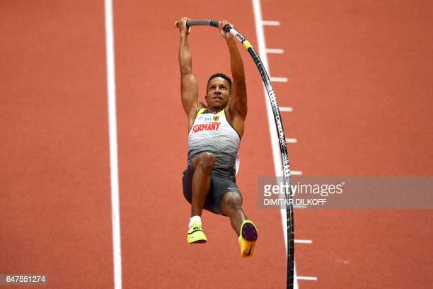 Germany's Raphael Holzdeppe competes in the men's pole vault final at the 2017 European Athletics Indoor Championships in Belgrade on March 3 2017 /...