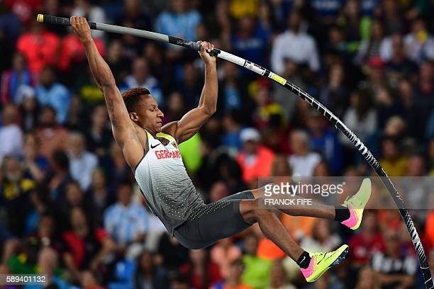 Germany's Raphael Marcel Holzdeppe competes in the Men's Pole Vault Qualifying Round during the athletics event at the Rio 2016 Olympic Games at the...