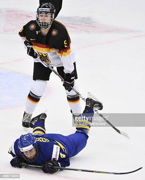 Germany's Rebecca Graeve vies with Sweden's Jenni Asserholt during the IIHF Ice Hockey Women's World Championship group B match between Germany and...
