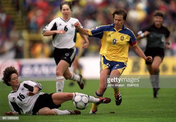 LR Germany's Renate Lingor tackle's Sweden's Malin Andersson