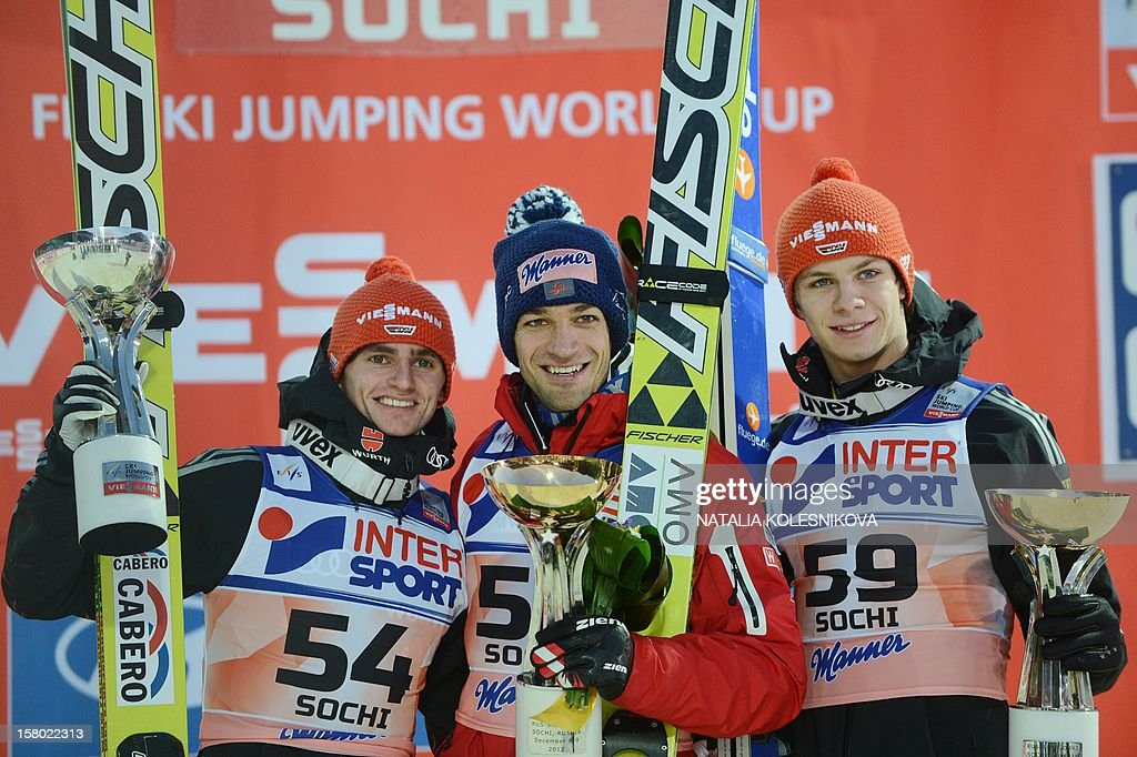 Germany's Richard Freitag (the second), Austria's Andreas Kofler (the first) and Germany's Andreas Wellinger (the third) celebrate after the men's normal hill individual at the FIS Ski Jumping World Cup tournament in Sochi on December 9, 2012.