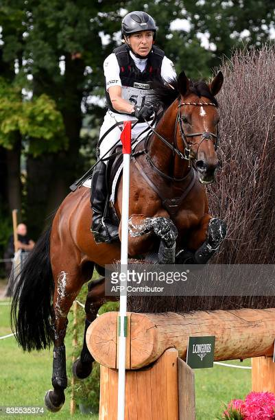 Germany's rider Ingrid Klimke and her horse Horseware Hale Bob OLD compete during the cross country competition of the FEI European Eventing...