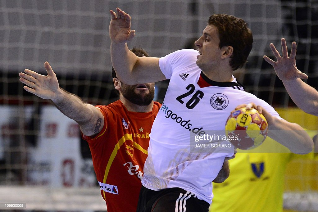 Germany's right back Adrian Pfahl vies with Spain's centre back Joan Canellas during the 23rd Men's Handball World Championships quarterfinal match...