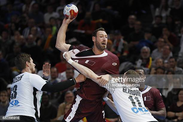 Germany's right back Holger Glandorf holds back Qatar's left back Bertrand Roine during the 25th IHF Men's World Championship 2017 eighth final...