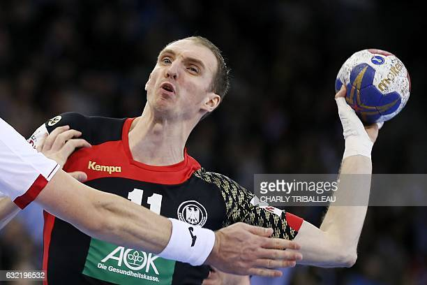 Germany's right back Holger Glandorf jumps to shoot on goal during the 25th IHF Men's World Championship 2017 Group C handball match Germany vs...
