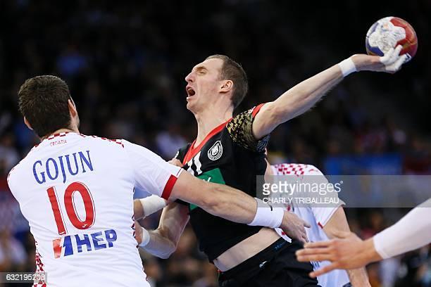 Germany's right back Holger Glandorf shoots on goal during the 25th IHF Men's World Championship 2017 Group C handball match Germany vs Croatia on...