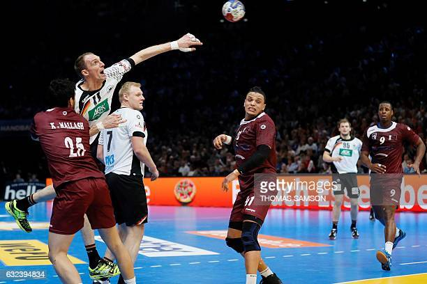 Germany's right back Holger Glandorf shoots on goal over Qatar's pivot Youssef Ali during the 25th IHF Men's World Championship 2017 eighth final...