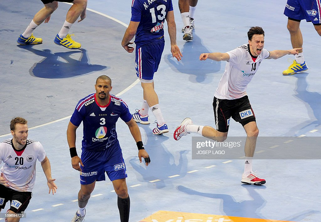 Germany's right wing Patrick Groetzki (R) celebrates after scoring during the 23rd Men's Handball World Championships preliminary round Group A match France vs Germany at the Palau Sant Jordi in Barcelona on January 18, 2013. Germany won 32-30.