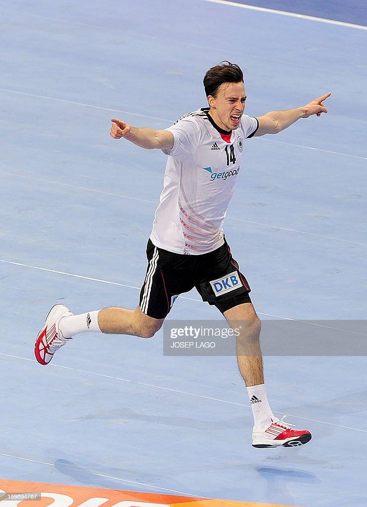 Germany's right wing Patrick Groetzki celebrates after winning the 23rd Men's Handball World Championships preliminary round Group A match France vs Germany at the Palau Sant Jordi in Barcelona on January 18, 2013. Germany won 32-30. AFP PHOTO/ JOSEP LAGO