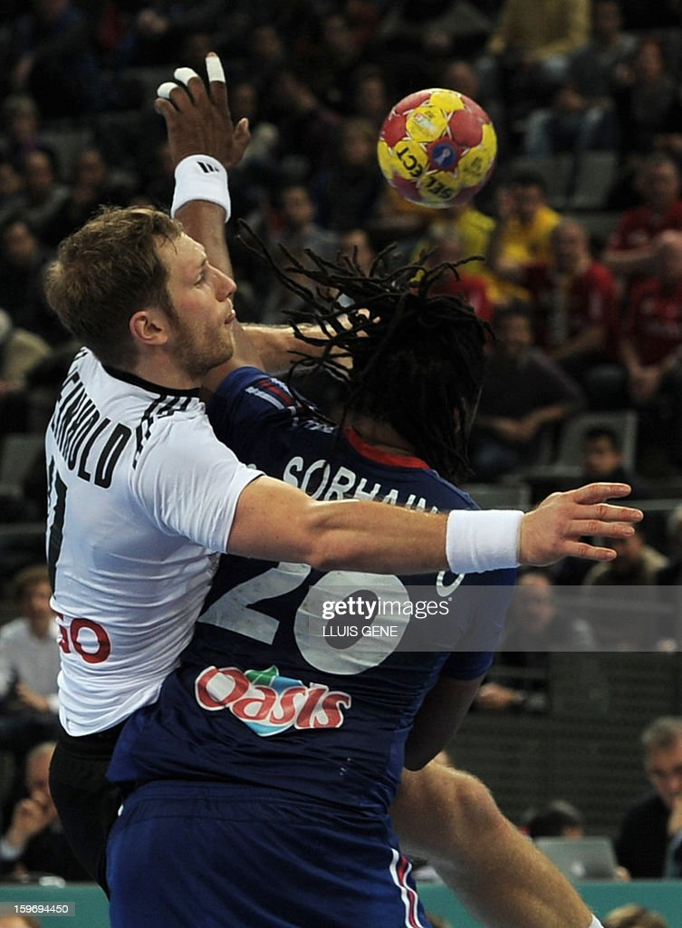 Germany's right wing Steffen Weinhold (L) vies with France's pivot Cedric Sorhaindo (R) during the 23rd Men's Handball World Championships preliminary round Group A match France vs Germany at the Palau Sant Jordi in Barcelona on January 18, 2013. AFP PHOTO/ LLUIS GENE