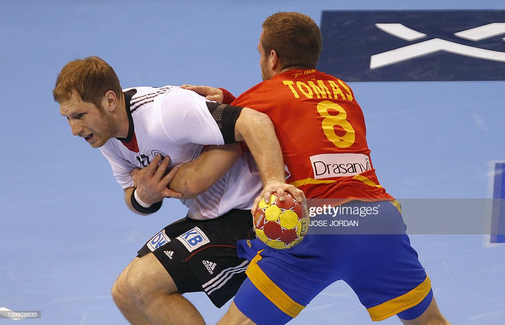 Germany's right wing Steffen Weinhold vies with Spain's right wing Victor Tomas during the 23rd Men's Handball World Championships quarterfinal match...