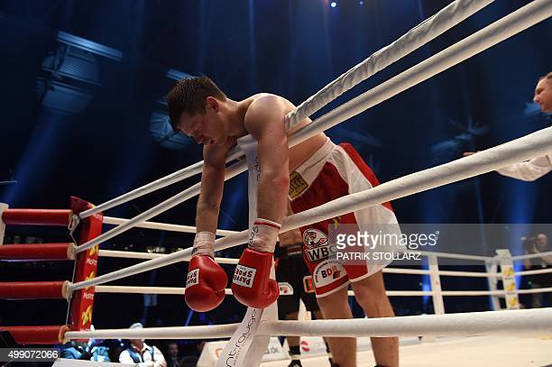 Germany's Robert Tlatlik hang over the ropes after being knockdown by compatriot Said Rahimi during the German Lightweight championship title bout in...