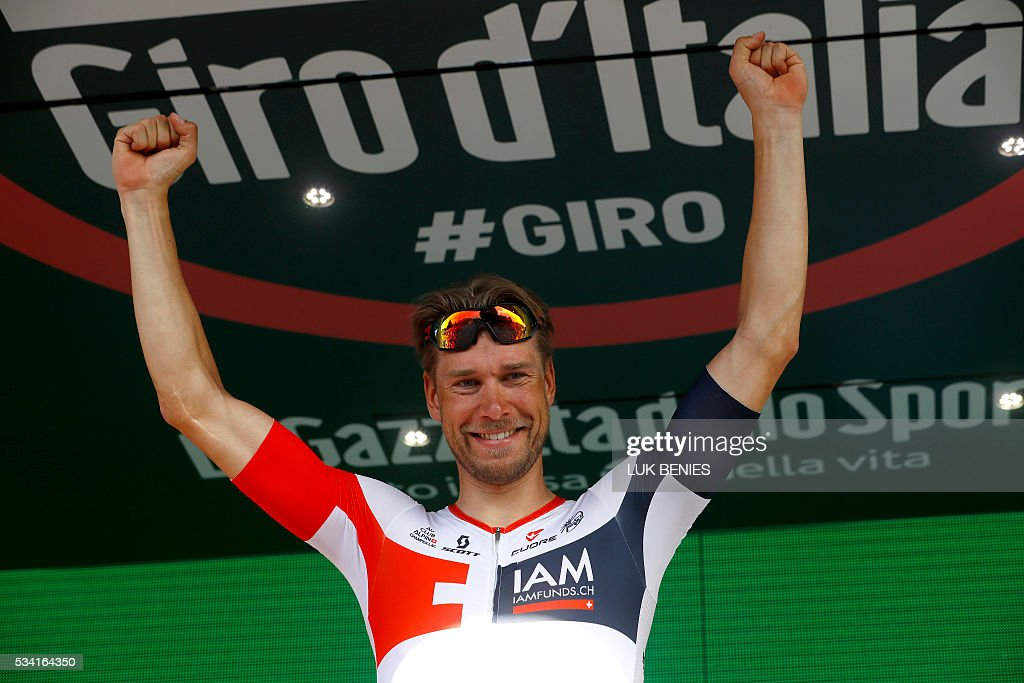 Germany's Roger Kluge (IAM) celebrates on the podium after winning the 17th stage of the 99th Giro d'Italia, Tour of Italy, from Molveno to Cassano d'Adda on May 25, 2016. / AFP / LUK