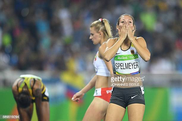 Germany's Ruth Sophia Spelmeyer reacts in the Women's 400m Semifinal during the athletics event at the Rio 2016 Olympic Games at the Olympic Stadium...