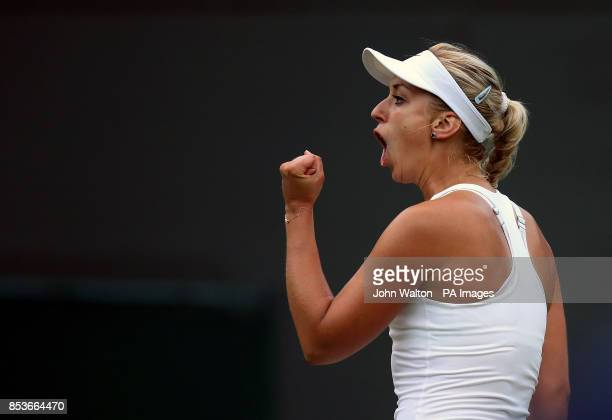 Germany's Sabine Lisicki celebrates a point against Serbia's Ana Ivanovic during day six of the Wimbledon Championships at the All England Lawn...