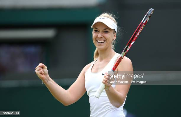 Germany's Sabine Lisicki celebrates defeating Serbia's Ana Ivanovic during day eight of the Wimbledon Championships at the All England Lawn Tennis...