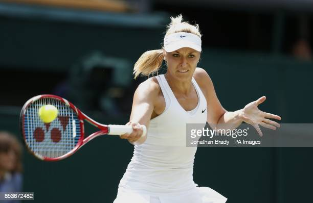 Germany's Sabine Lisicki in action against Romania's Simona Halep during day ten of the Wimbledon Championships at the All England Lawn Tennis and...