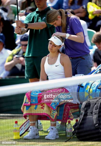 Germany's Sabine Lisicki receives treatment during a medical time out during her match against Kazakhstan's Yaroslava Shvedova during day nine of the...