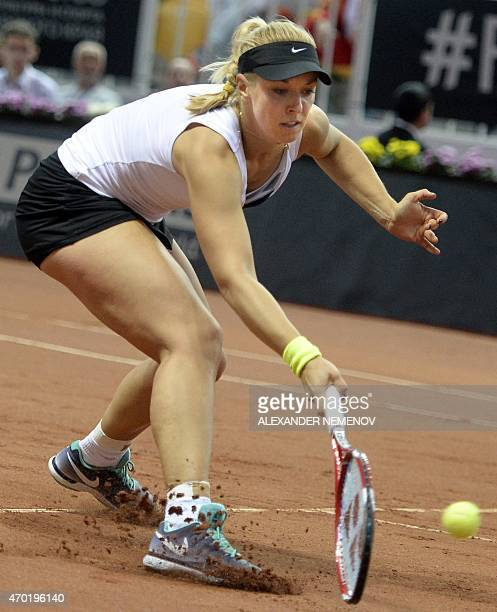 Germany's Sabine Lisicki returns the ball to Russia's Anastasia Pavlyuchenkova during their Federation Cup tennis world group semifinal match between...