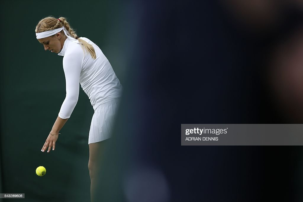 Germany's Sabine Lisicki serves against US player Shelby Rogers during their women's singles first round match on the first day of the 2016 Wimbledon Championships at The All England Lawn Tennis Club in Wimbledon, southwest London, on June 27, 2016. / AFP / ADRIAN