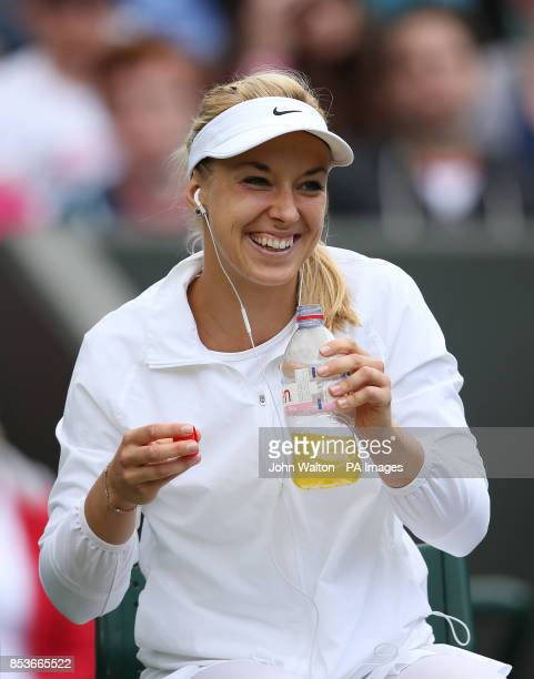 Germany's Sabine Lisicki smiles before her match against Serbia's Ana Ivanovic during day eight of the Wimbledon Championships at the All England...