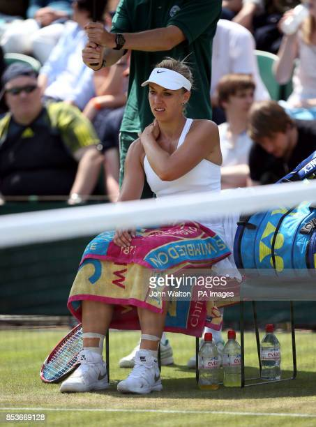 Germany's Sabine Lisicki waits for a medical time out during her match against Kazakhstan's Yaroslava Shvedova during day nine of the Wimbledon...