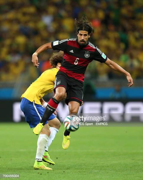 Germany's Sami Khedira and Brazil's David Luiz battle for the ball