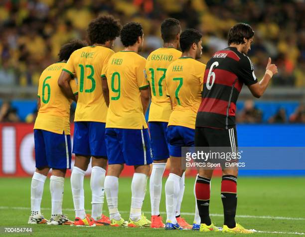 Germany's Sami Khedira attempts to disrupt the Brazil wall for the free kick