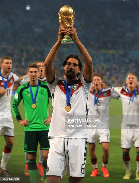 Germany's Sami Khedira celebrates with the FIFA World Cup Trophy