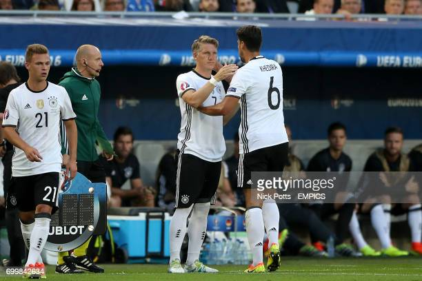 Germany's Sami Khedira is replaced by teammate Bastian Schweinsteiger early in the first half