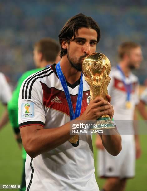 Germany's Sami Khedira kisses the FIFA World Cup Trophy
