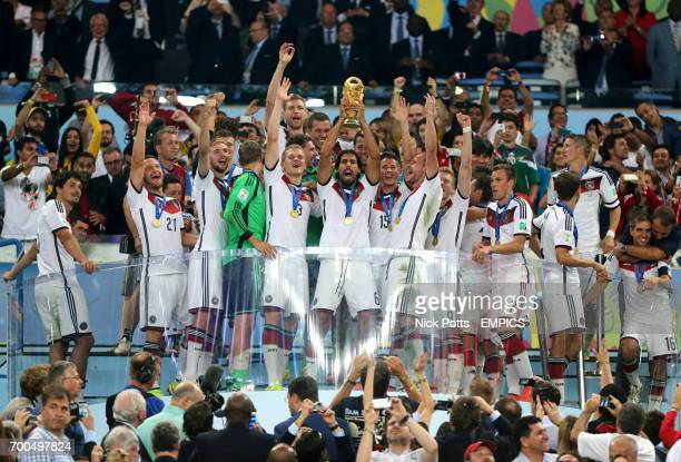 Germany's Sami Khedira lifts the FIFA World Cup trophy after the game